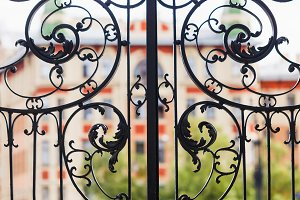 Black vintage forged gates in Europe