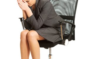 Depressed businesswoman sitting on