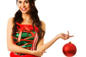 Woman hanging christmas bubble on