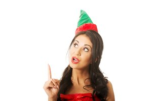 Surprised woman wearing elf clothes