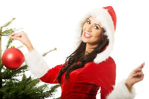 Smiling woman wearing santa claus