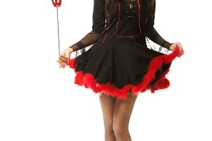 Woman wearing devil clothes holding