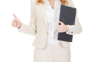 Businesswoman showing thumbs up with