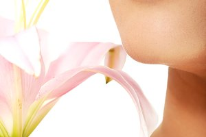 Female lips and lily flower.