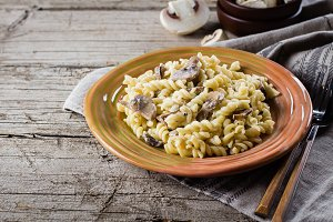 Italian pasta fusili with mushrooms