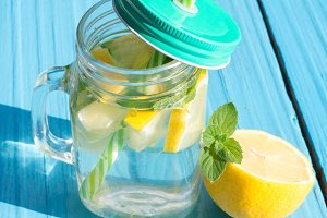 Lemonade with lemon and mint in a gl