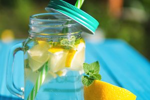 Lemonade in a glass jar with slices