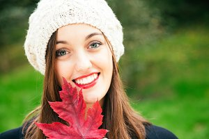 Autumn beauty with a red leaf