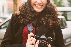Cute photographer woman on the stree