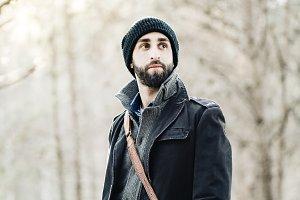 trendy guy wearing hat in park