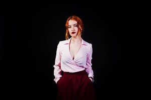 Portrait of a redheaded girl in pink