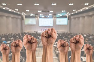People Fists raised fighting for pro