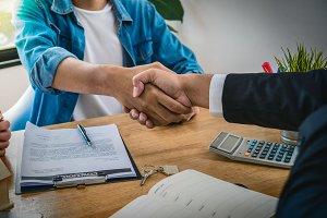 Closeup Hand shake between sale repr
