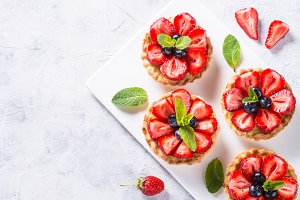 Strawberry tart on white. Summer