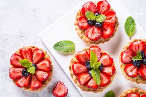 Strawberry tart on white table. Top