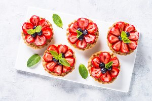 Strawberry tart on white background