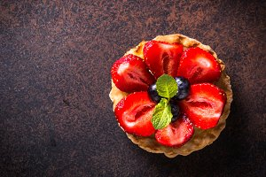 Strawberry tart on dark table. Top