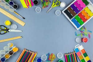 School supplies on a grey background