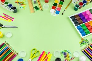School supplies on a green backgroun