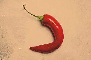Red hot chili pepper on a gray stone