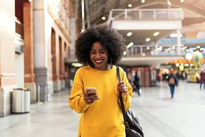 Beautiful woman using the mobile