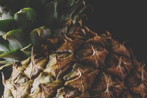 Fresh pineapple, dark wood backgroun