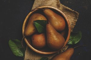 Fresh autumn brown pears in a bowl,