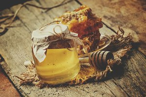 Mountain honey in a glass jar and ho