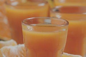 Fresh tangerine juice with slices of