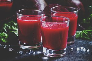 Beetroot juice in glasses on a dark