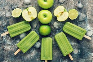 Green popsicles on a rustic