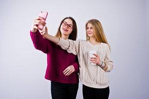 Two girls in purple dresses taking s