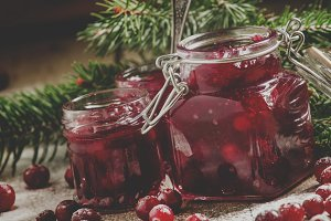 Winter cranberry sauce in glass jars