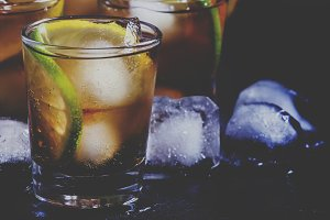 Alcoholic cocktail rum cola with ice