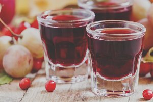 Homemade red wine glasses on the aut