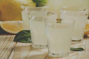 Homemade lemon liqueur and fresh lem