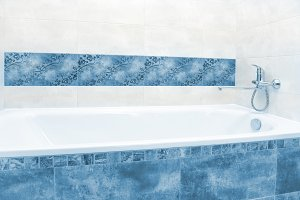 Close up of white and blue bathtub