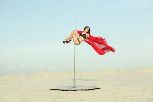 Woman is spinning on the pole.