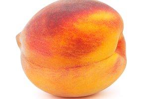Fresh yellow peach isolated on white