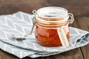 Glass jar with cloudberry jam