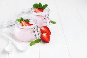 Jars with strawberry yogurt