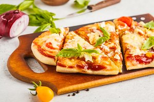 Oval homemade pizza with feta cheese