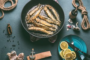 Fried sardines in frying pan