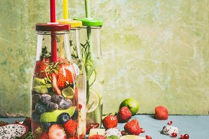 Bottles with fruits infused water