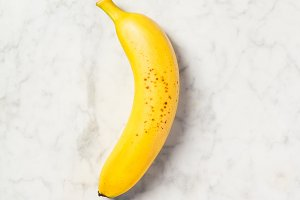 Banana on white marble table