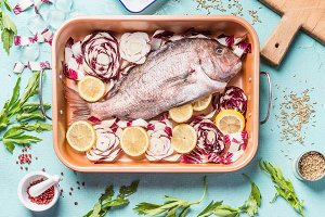 Raw whole fish in baking tray