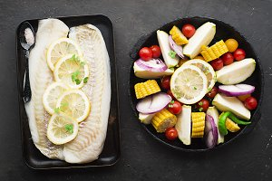 Two dishes before baking: cod with