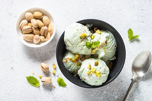 Pistachios ice cream in bowl on