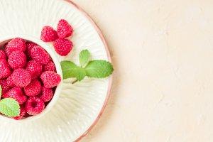 Ripe raspberries with green mint