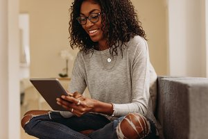 Woman using tablet pc sitting